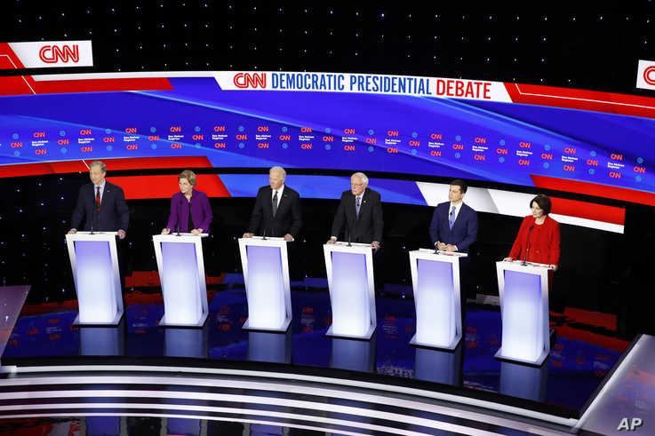 From left, Democratic presidential candidates businessman Tom Steyer, Sen. Elizabeth Warren, D-Mass., former Vice President Joe…