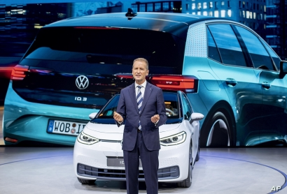 FILE - CEO of Volkswagen Herbert Diess introduces the new VW ID.3 at the IAA Auto Show in Frankfurt, Germany, Sept. 9, 2019.