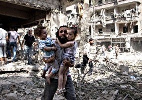 A Syrian man carries his two two girls a...A Syrian man carries his two two girls as he walks across the rubble following a barrel bomb attack on the rebel-held neighbourhood of al-Kalasa in the northern Syrian city of Aleppo on September 17, 2015. Once Syria's economic powerhouse, Aleppo has been ravaged by fighting since the rebels seized the east of the city in 2012, confining government forces to the west. AFP PHOTO / KARAM AL-MASRI KARAM AL-MASRI/AFP/Getty Images