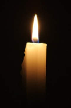 stock-photo-1558636-lit-candle