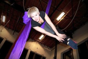 aerial fitness classes yoga exercise upper limits indoor rock climbing gym downtown st. louis
