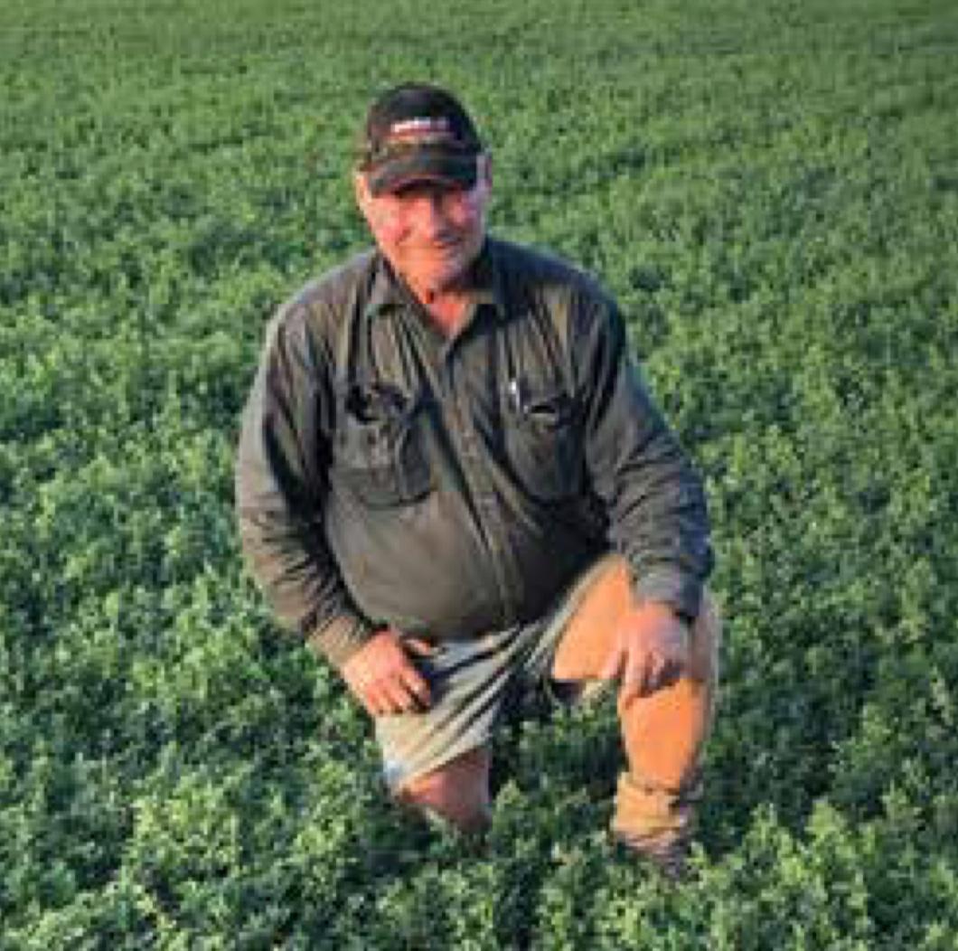 Rod Henderson Kneeling in Grass