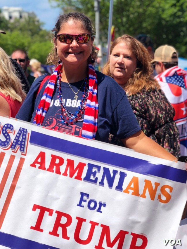 "Caroline Sarajian shows off her ""Armenians for Trump"" banner, July 4, 2019, on the National Mall in Washington."