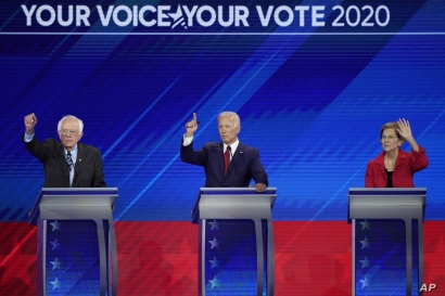 From left, Democratic presidential candidates Sen. Bernie Sanders, I-Vt., former Vice President Joe Biden and Sen. Elizabeth Warren, D-Mass. raise their hands to answer a question Thursday, Sept. 12, 2019, during a Democratic presidential primary…