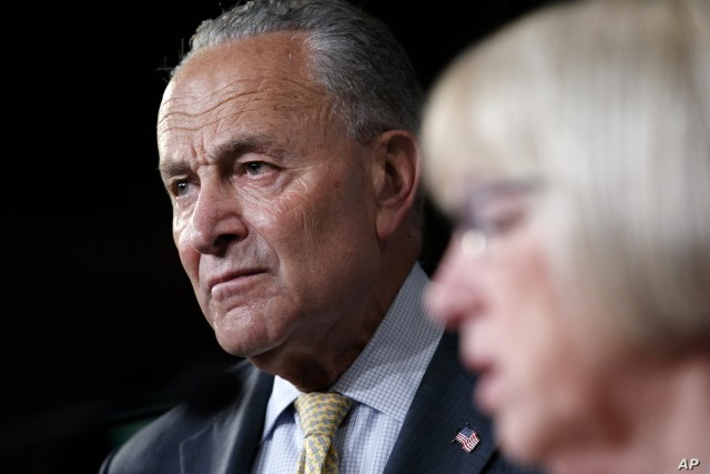Senate Minority Leader Sen. Chuck Schumer of N.Y. (L) listens as Sen. Patty Murray, D-Wash., speaks at a news conference on proposed legislation regarding detention of immigrants on the southern border, July 11, 2019, Capitol Hill, Washington.