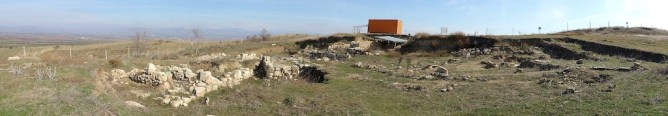 The orange shipping container is the office for when the dig site is active. Acropolis ruins and main entrance to the city.