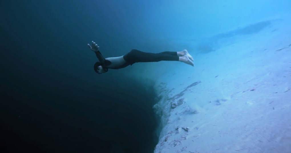 cliff diving into an underwater abyss