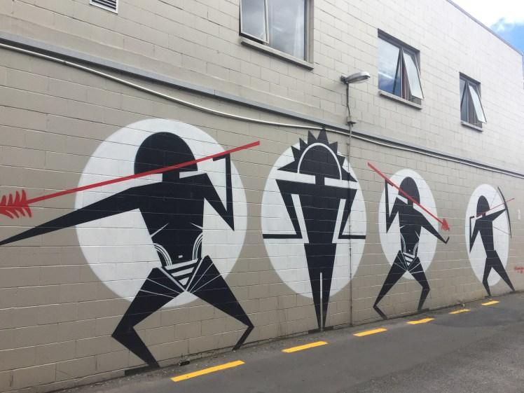 graffiato street art, Taupo, tribal figures with arrows