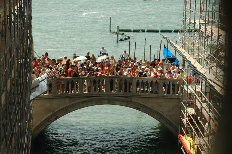 overtourism in venice : bridge overflowing with tourists