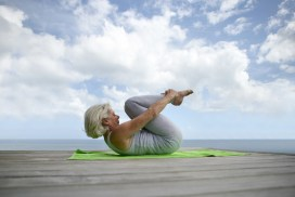 older woman doing yoga