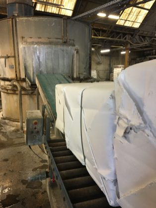 Raw cotton paper pulp is added to the pulper.
