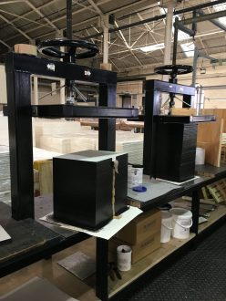 Drawing and painting pads are set to dry in these custom outfitted presses.