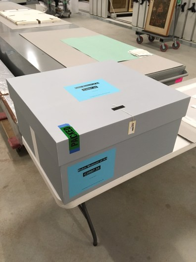 Lid has been placed, the box has been labeled, and the piece is ready for storage. The gummed cambric is visible on the left side.
