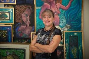 2015-10-12-Anita-in-front-of-art-smiling-horiz