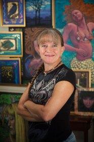 2015-10-12-Anita-in-front-of-art-smiling-vertical