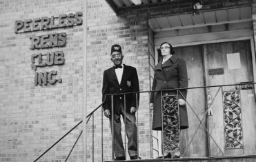 James (Punch) and Myrtle Jackson, original members who acquired the loan to start building the club, standing outside.