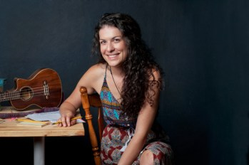 Jessie photographed with musical instruments and incentives for her students.