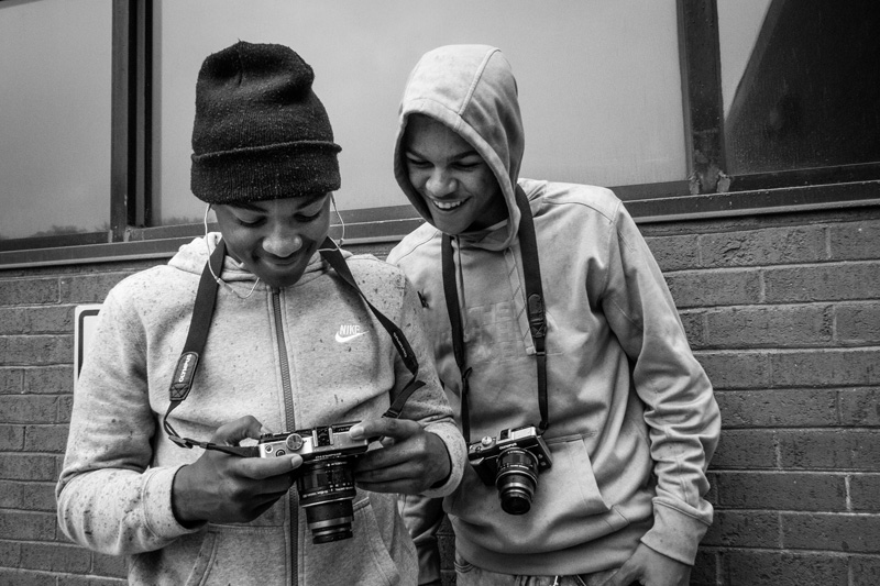 Nelson and Ricco review their photos after practicing portraits during the second day of Vision Workshops.