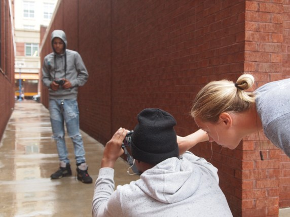 Allison helps Nelson set up his portrait of Ricco on West Street in Downtown Annapolis.