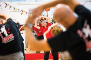 Billy Greer leads a warm up during a Tai Chi class.