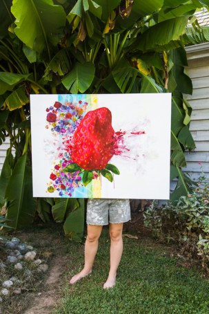"Artist Stephanie Claire Baker with her exploding strawberry acrylic painting titled ""Absolutely none of it"" Photo by Mary Ella Jourdak"