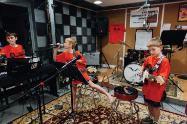 Zacca takes the keyboard while James takes the mic and Charlie plays lead guitar. The band practices in James' basement. James' parents are also musicians and have created a studio that the family and band can use.