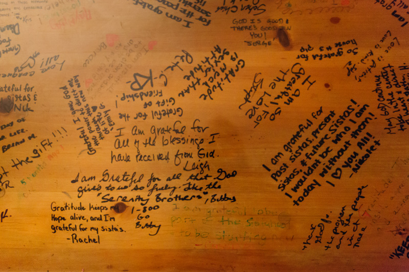The coffee table in one of the Serenity Sista homes is filled with gratitude notes from former women living in the home.