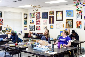 Open Eye Gallery Director, Corinna Woodard chats with Michelle Brookshire about her art piece during an open studio at the Arundel Lodge art space. The Open Eye Gallery and art program at Arundel Lodge in Edgewater provides a creative space for adults impacted by mental health and substance use disorders. Many of their works are shown around the area at various galleries and museums and sold to the community to pay the artists and cover supply expenses. Photos by Alison Harbaugh. Sugar Farm Productions