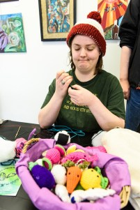 Margaret Kay creates crocheted animals and food items that she sells at The Open Eye Gallery and art program at Arundel Lodge in Edgewater. The gallery provides a creative space for adults impacted by mental health and substance use disorders. Many of their works are shown around the area at various galleries and museums and sold to the community to pay the artists and cover supply expenses. Photos by Alison Harbaugh. Sugar Farm Productions