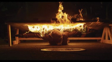 """Fire Angel (2014) my body in flames, scorching a """"fire angel"""" into a panel of reclaimed wood."""