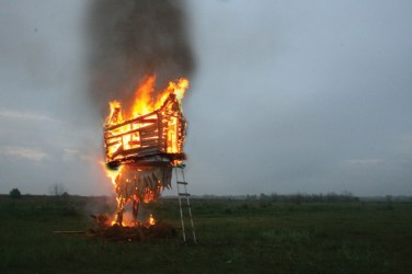 "burning of the ""Baba Yaga Hut"" (2015) 10'l x 6'w x 20'h Mixed reclaimed materials Southern Louisiana-fire."