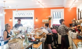 A busy Friday morning at Bakers and Co. in Eastport. Customers come in for fresh baked breads, pastries, soups and coffee and tea drinks. If needed...behind the counter: Hannah Hall, Emily Tahaburt, & Joel Bourland. Photo by Alison Harbaugh