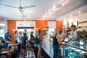A busy Friday morning at Bakers and Co. in Eastport. Customers come in for fresh baked breads, pastries, soups and coffee and tea drinks. If needed...behind the counter: Hannah Hall, & Joel Bourland. Photo by Alison Harbaugh