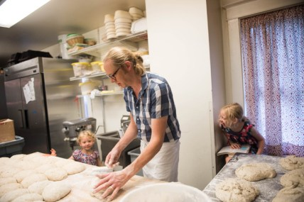 Daughter Gwen and Julia watch on as their father, Chris Simmons prepares bread dough at family-owned Bakers and Co. in Eastport. Photo by Alison Harbaugh