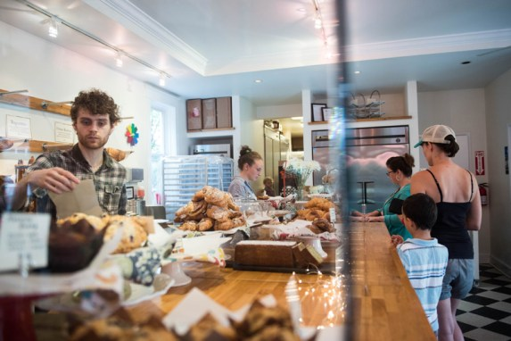 A busy Friday morning at Bakers and Co. in Eastport. Customers come in for fresh baked breads, pastries, soups and coffee and tea drinks. If needed...behind the counter: Joel Bourland &Hannah Hall Photo by Alison Harbaugh