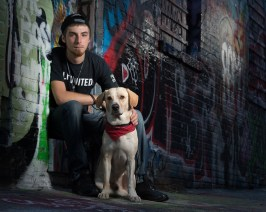 Frank Goldberger and his dog, Sargent, in Graffiti Alley, Baltimore. Frank and Sargent walked together from New Orleans to Baltimore. Frank is a graffiti artist.