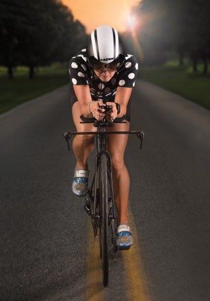 Triathlete Ana Miller training on Greenbury Point Road, Annapolis, MD.