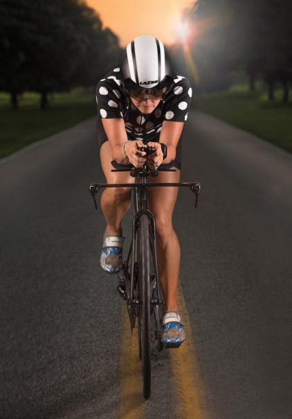 Triathlete Ana Miller training on Greenbury Point Road, Annapolis, MD.
