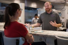 Owner Brandon Stalker chats with a customer during the lunch rush on September 26, 2018.