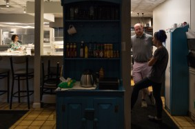 Owner Brandon Stalker and manager Autumn Scheeler talk in the kitchen in the early morning of October 8, 2018.