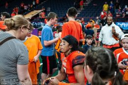 Albany Empire wide receiver Malachi Jones meets with fans following the team's win on Saturday night. Photo: Jon Monaghan/UC Sports