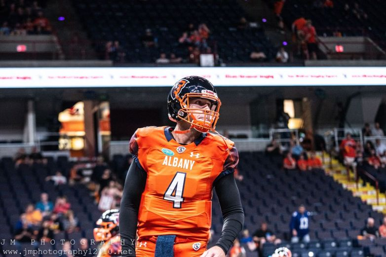 Empire quarterback Tommy Grady warms up prior to Saturday's game in Albany. Photo: Jon Monaghan/UC Sports