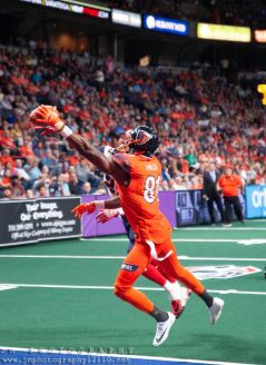 Empire wide receiver Joe Hills catches a pass during Saturday night's game. Photo: Jon Monaghan/UC Sports