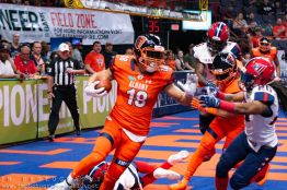 Albany Empire wide receiver Jordan Williams (18) breaks tackles during a kick return on Saturday night in Albany. Photo: Jon Monaghan/UC Sports