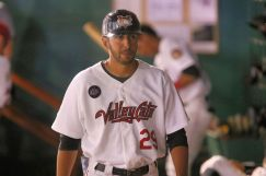 ValleyCats manager Jason Bell walks through the dugout during Thursday's game. Photo: Robert Dungan/The Upstate Courier