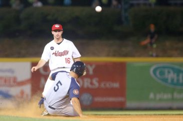 ValleyCats infielder Austin Dennis (16) throws the ball to first base while Cyclones infielder Chase Chambers (5) slides into second. Photo: Robert Dungan/The Upstate Courier