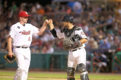 ValleyCats pitcher RJ Freure (36) fist bumps with catcher Cesar Salazar on Thursday. Photo: Robert Dungan/The Upstate Courier