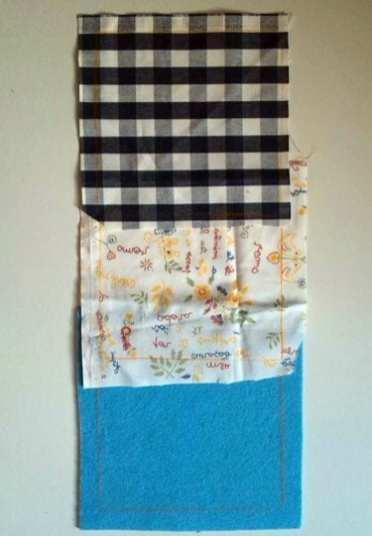 Colocar o quadrado de papel em cima dos pedaços de tecidos e do feltro e marcar com o lápis de cor.