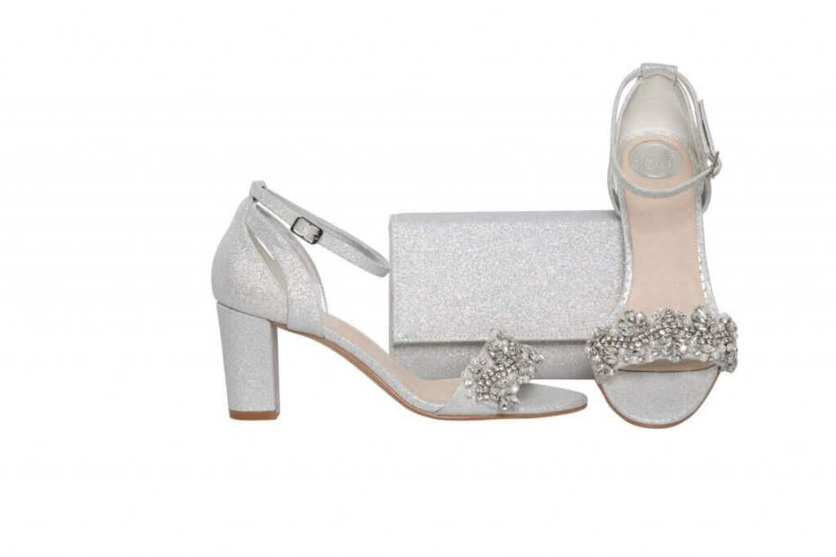 Perfect Bridal silver sparkle shoes with block heel and ankle strap alongside matching clutch handbag