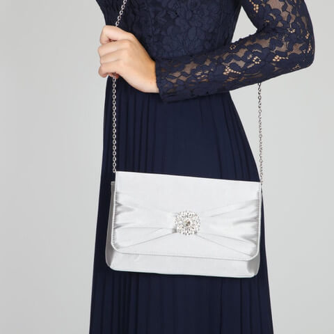 Perfect Bridal satin silver evening bag. Has an elegant gathered front flap with light-catching crystal flower brooch detail